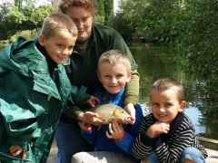 Happy youngsters having fishing lessons